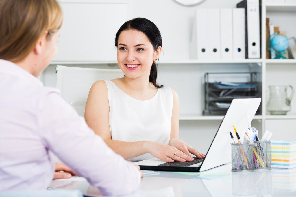 Girl talking to her client