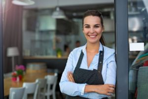 smiling restaurant owner