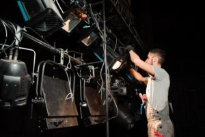 stage staff fixing the light