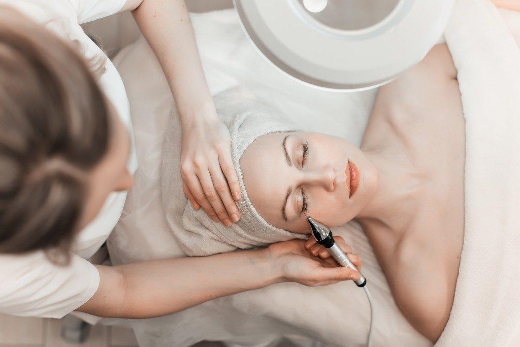 Getting facial at a dermatology clinic