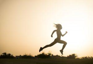 woman taking large strides