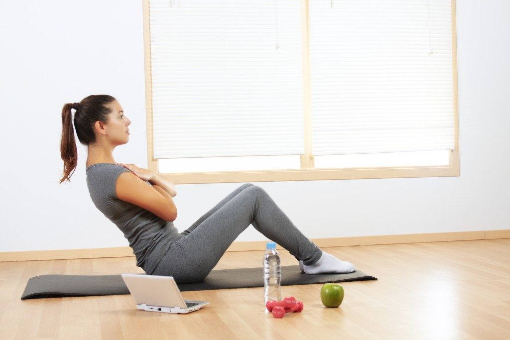 Woman doing sport exercises at home