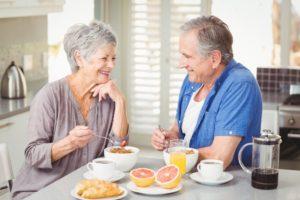 senior couple eating breakfast