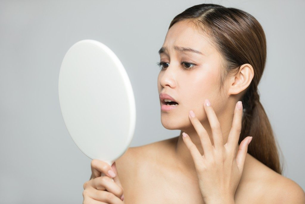 woman checking her skin