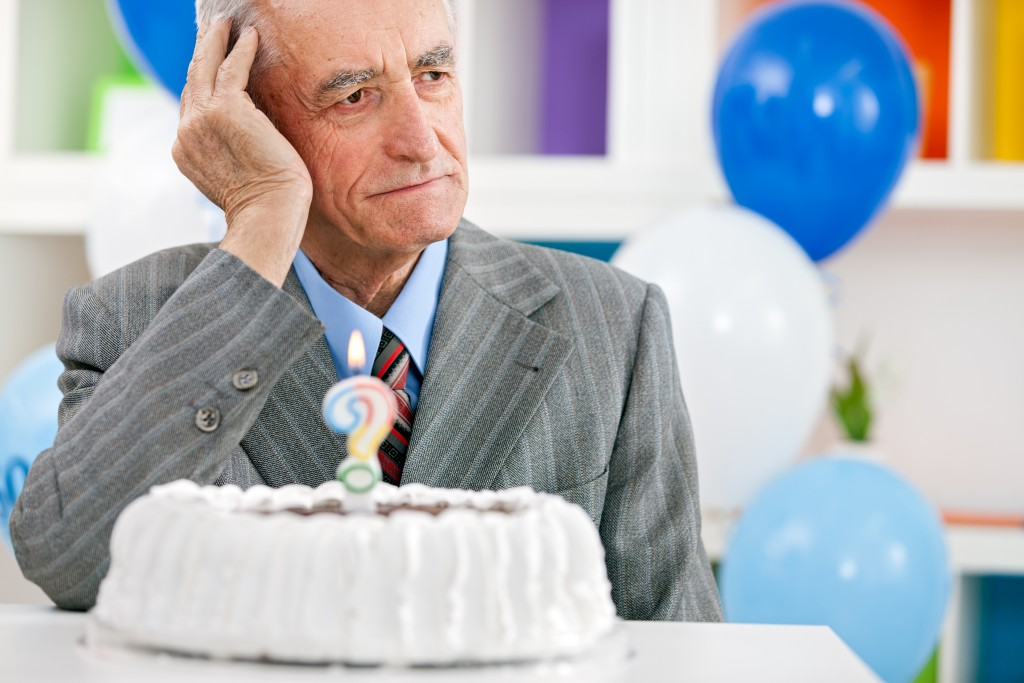 old man celebrating his birthday