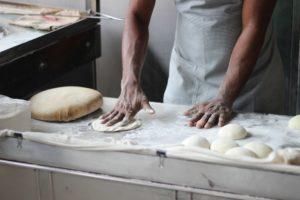 man baking dough